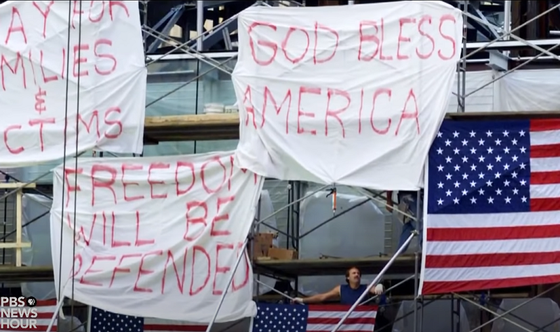 draped flags and signs after 9/11