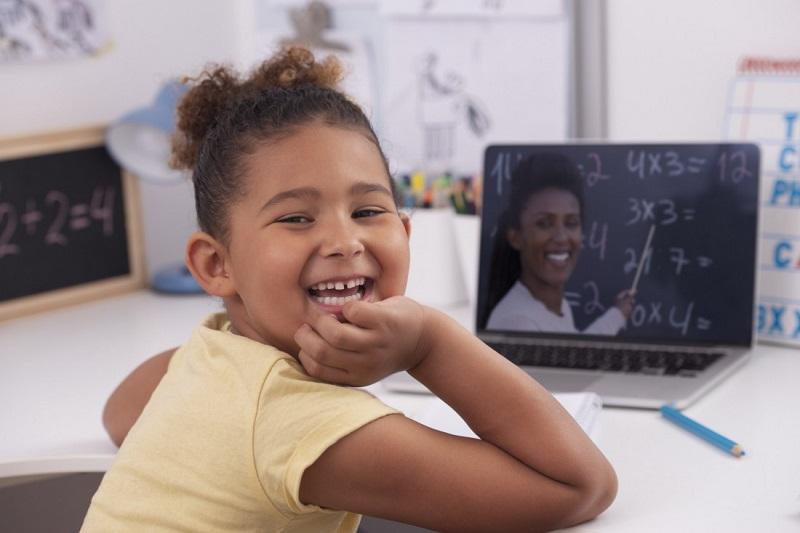 girl smiling during virtual learning