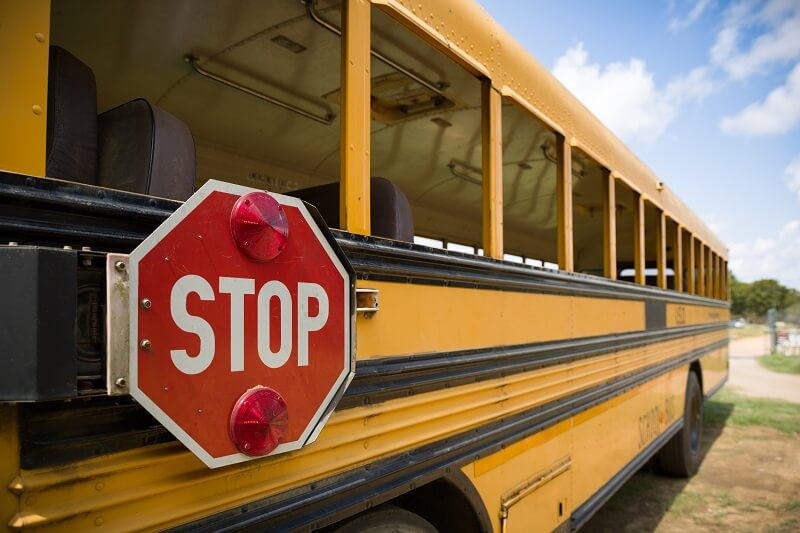 school bus and stop sign at bus stop