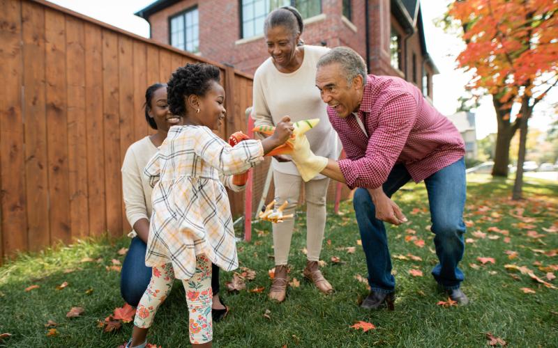 family celebrating thanksgiving outside