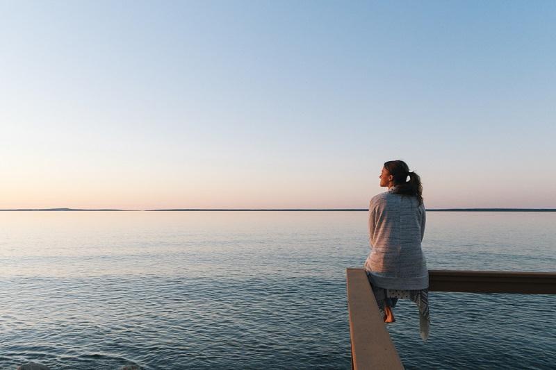 woman sitting on pier 3 tips tired teachers