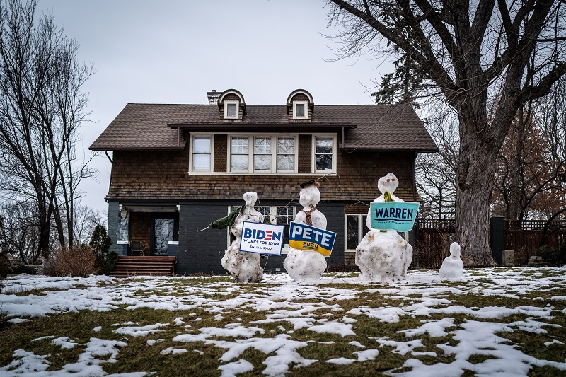 Student Voice makes a difference on the campaign trail. In this photo, Melting snowmen hold signs for three different presidential candidates on the front lawn of a home in Des Moines.