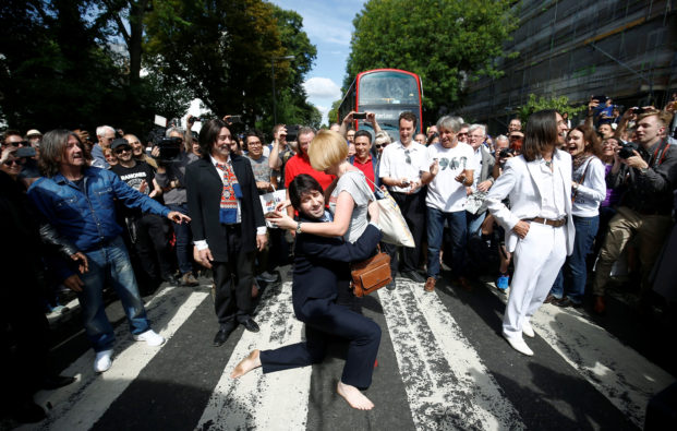 Musical education and inspiration with fans recreating the Beatles' famed moment at Abbey Road