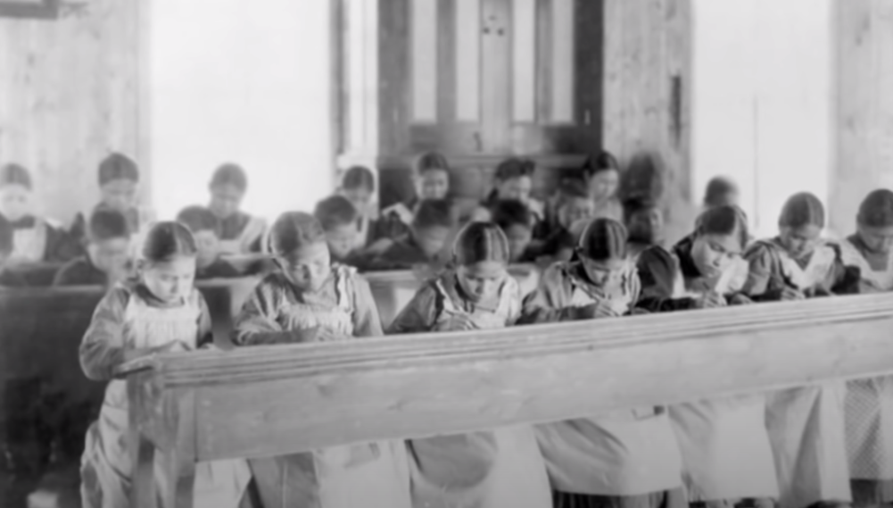 Indigenous children at a residential boarding school after being taken from their communities.