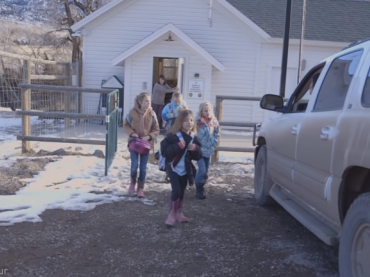 Children exiting the one room schoolhouse in Cody, Wyoming.