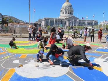 Students, educators and activists participate in designing one of the largest street murals ever in pursuit of environmental justice and putting an end to the dangers of climate change.