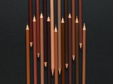 anti-racist action in the classroom - colored pencils making a heart shape