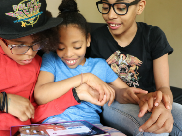 family playing icivics games
