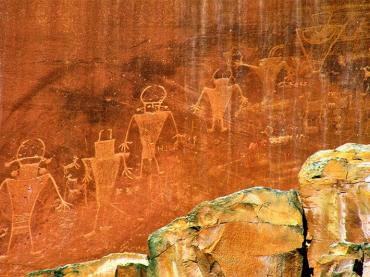 Native American History Month - Native American petroglyphs in Capitol Reef National Park along the Fremont River in Wayne County Utah USA. Modern Hopi and Zuni peoples interpretate that these have great spiritual significance. Recording clan migrations, ceremonial activities, supernatural deities, and plants and animals found in the area.