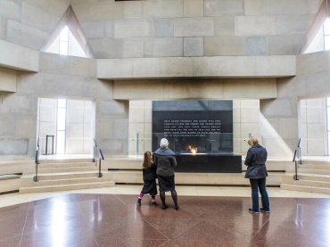 Visitors view the eternal flame in the Hall of Remembrance at the US Holocaust Museum in Washington, DC on March 19, 2015.