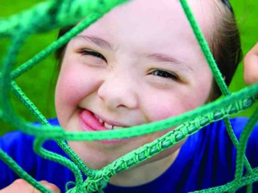girl with special needs playing outdoors