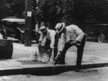 Pouring whiskey into a sewer, 1921.