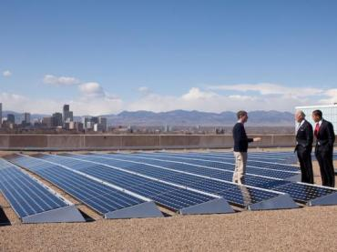 President Obama and Vice President Biden speak with Blake Jones, CEO of Namaste Solar Electric, Inc., while looking at solar panels. Denver, Colorado, 2009.