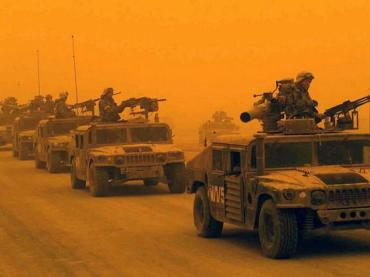 A convoy of U.S. Marine Corps (USMC) arrives in Northern Iraq during a sandstorm, March 2003.