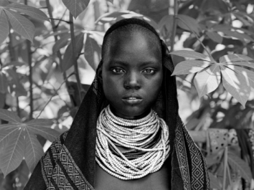 Teenage Kara girl from the Omo River Valley in southwestern Ethiopia. Her community is on the verge of losing their culture and self-sustaining way of life.