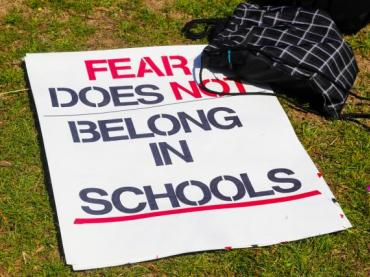"Protest sign declaring, ""Fear does not belong in Schools.""+"