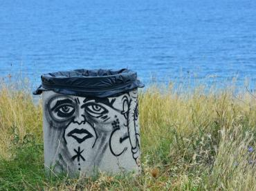 pixabay trashcan near lake