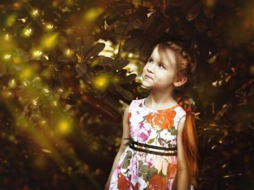 Girl watching fireflies emit bioluminescence