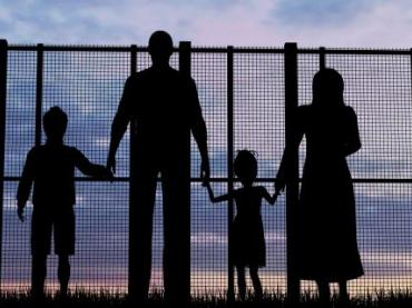 https://www.istockphoto.com/photo/silhouette-of-a-refugees-family-with-children-gm583734616-99888897