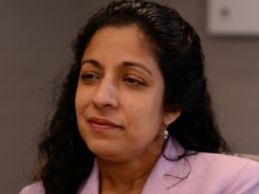 Neena Chaudhry, Director of Education and Senior Council, National Women's Law Center, talks with students about Title IX, a federal civil rights law that protects them from sex discrimination.