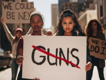 Two young women protesting gun violence.