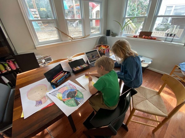 kelly's children working on distance learning at a desk