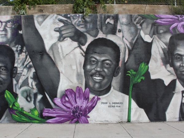 A mural of Gary, Indiana steel workers by Gaia
