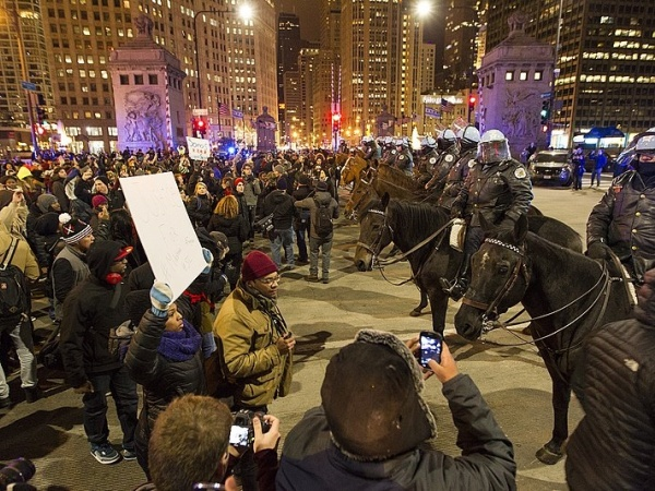 Protesters and police converge at Michigan Ave and Wacker Drive in Chicago following the news that Ferguson Missouri police officer Darren Wilson will not be charged in the Aug 9 shooting of unarmed 18-year old Michael Brown. The demonstrations in Chicago remained peaceful and there were no reported arrests. 11/25/2014