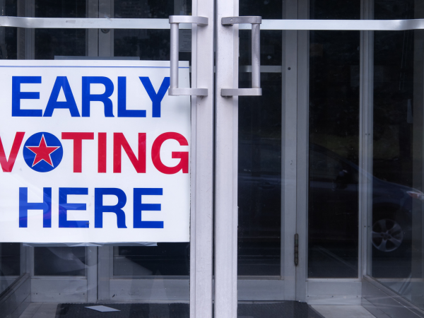early voting sign in a doorway