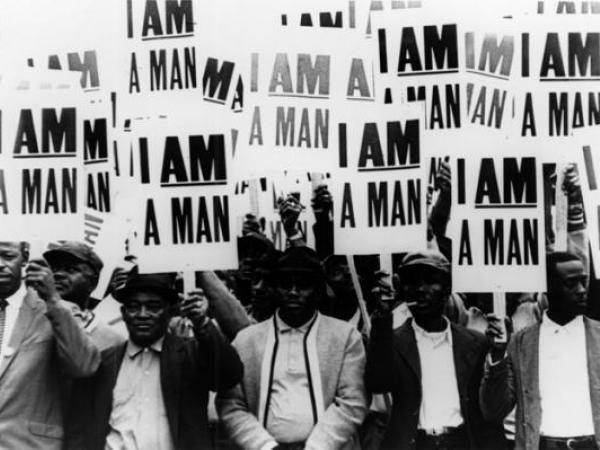 Striking members of Memphis Local 1733 hold signs whose slogan symbolized the sanitation workers' 1968 campaign.