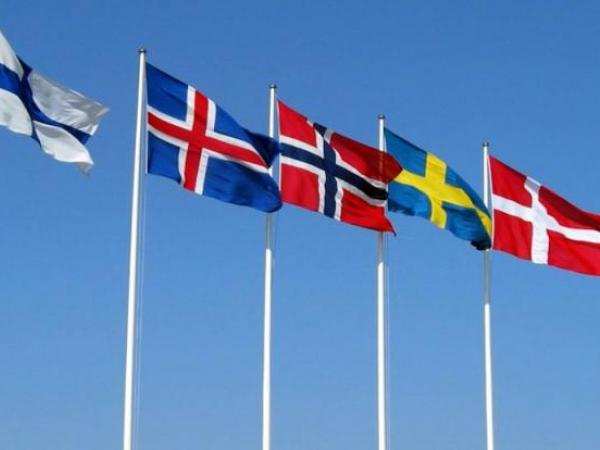 Flags of the Nordic countries, all of which are social democracies.