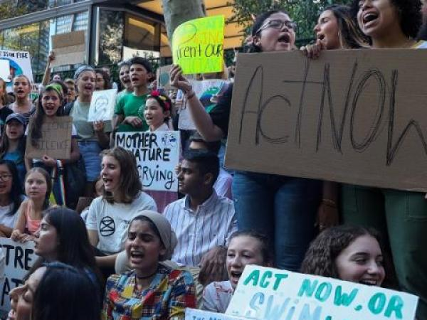 Photo of a crowd of young adult protesting climate change