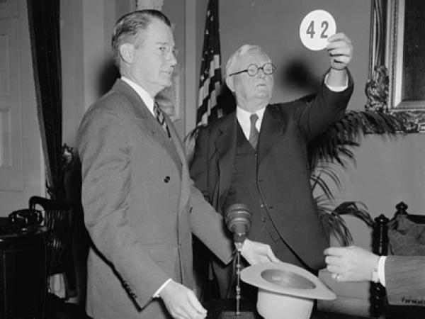 Vice President John Garner selects at random the number of the postal route to be sampled during the 1937