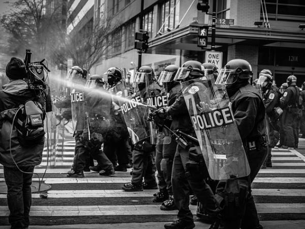 https://pixabay.com/en/people-police-protest-water-shield-2591693/