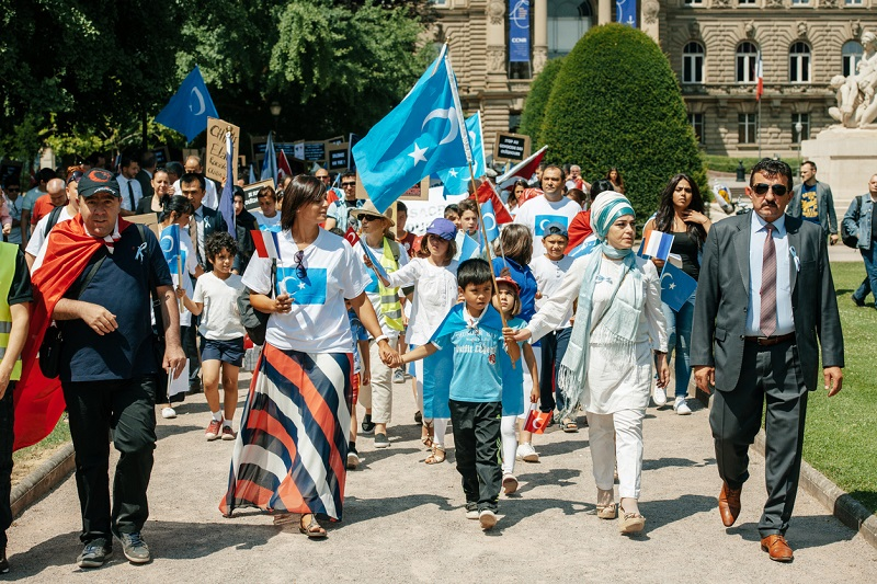 Uyghur human rights activists participate in a demonstration to protest against Chinese government's policy in Uyghur